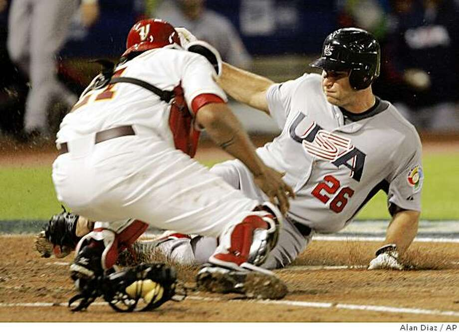 United States' Chris Iannetta (26) is tagged out at home plate by Venezuela catcher Henry Blanco in the second inning during the second round of the World Baseball Classic in Miami, Wednesday, March 18, 2009. (AP Photo/Alan Diaz) Photo: Alan Diaz, AP