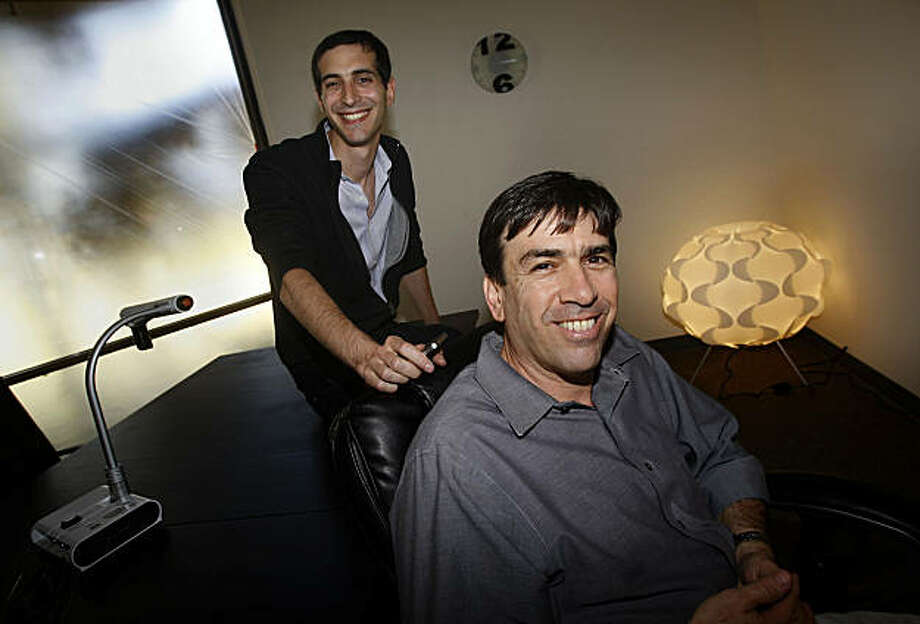 Co-founders chief executive officer Uri Raz (front) and chief technical officer Eric Setton (back) in a conference room in the offices of Tango, a popular mobile phone application, in Palo Alto, Calif., on Tuesday, October 19 2010.  Tango lets users make video calls across different phones and networks across the globe for free. The program was downloaded 1 million times in its first 10 days, and could indicate a pent up demand for such services. Photo: Liz Hafalia, The Chronicle