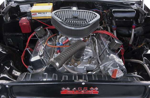 At the look at the engine in Jim Theisen's 1957 Pontiac Chieftain. Photo: Stephen Finerty