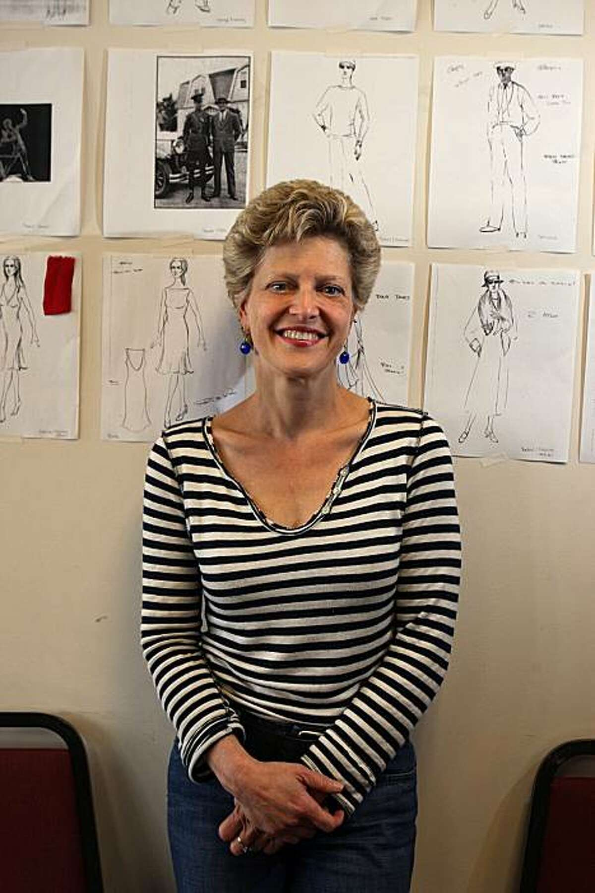 The Tosca Project co-creator and A.C.T. artistic director Carey Perloff in front of examples of the costume design for the show by Robert de La Rose at ACT's studio in San Francisco, Calif., on Friday, May 21, 2010. . Costume sketches made by Taisia Nikonishenko.