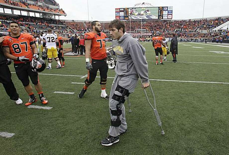 California's quarterback Kevin Riley (13) walks off the field on crutches following  NCAA college football game with Oregon State Saturday, Oct. 30, 2010, in Corvallis, Ore. Oregon State defeated California 35-7. Photo: Rick Bowmer, AP
