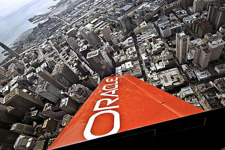 A stunt plane sponsored by Oracle Corp. is flown by Sean Tucker over San Francisco, California, U.S., on Wednesday, Oct. 6, 2010. Oracle, the world's second-largest software company, acquired almost 70 companies in the past five years. Photographer: Chip Chipman/Bloomberg Photo: Chip Chipman, Bloomberg
