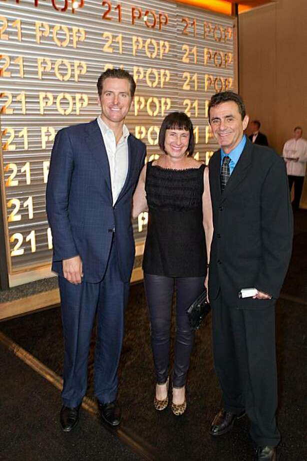 The third annual SF20, a modern art and furnishings expo at Fort Mason on Sept. 16, 2010, raises money for SFMOMA. It was more crowded than ever, a sign of the event's increasing popularity. Here, from left to right:  Mayor Gavin Newsom, honorary chair Carla Emil, and museum director Neal Benezra. Photo: Drew Altizer