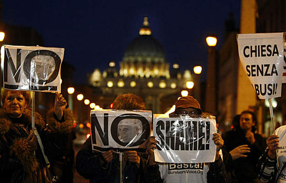 "Demonstrators hold placards during a protest near St. Peter's square, in Rome, Sunday, Oct. 31, 2010. Italian paramilitary police blocked a boulevard leading to the Vatican to prevent a march in Rome on Sunday by survivors of clergy sex abuse from reaching St. Peter's Square. When Vatican spokesman the Rev. Federico Lombardi came to speak with organizers Sunday evening, a protester shouted ""Shame, shame'' in Italian, and Lombardi left, escorted by police. The placard at right reads, Church without abuses. Photo: Pier Paolo Cito, AP"