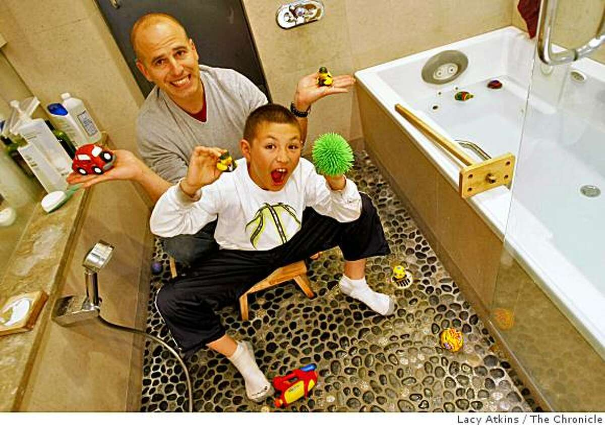 Stephen Leist and his son Cato, 10 years old, share bath time together in their Japanese bath, Tuesday March 3, 2009, at their home in Piedmont, Calif.