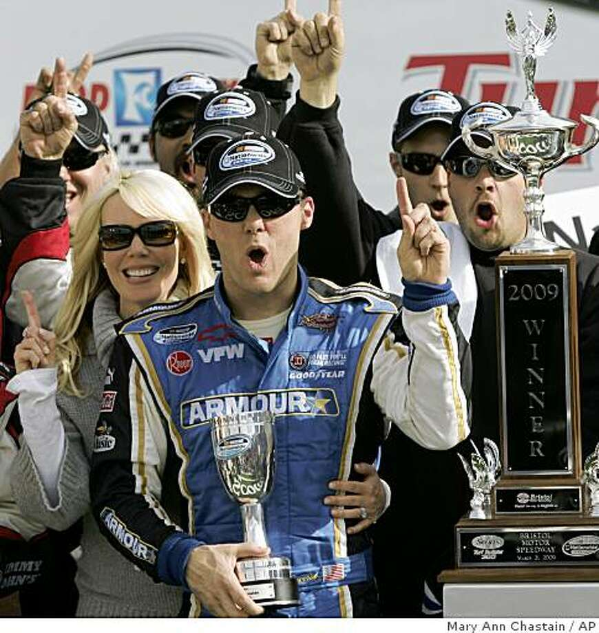 Kevin Harvick with his wife Delana Harvick celebrate with his crew after winning the NASCAR Nationwide Scotts Turf Builder 300 auto race in Bristol, Tenn. Saturday, March 21, 2009. (AP Photo/Mary Ann Chastain) Photo: Mary Ann Chastain, AP