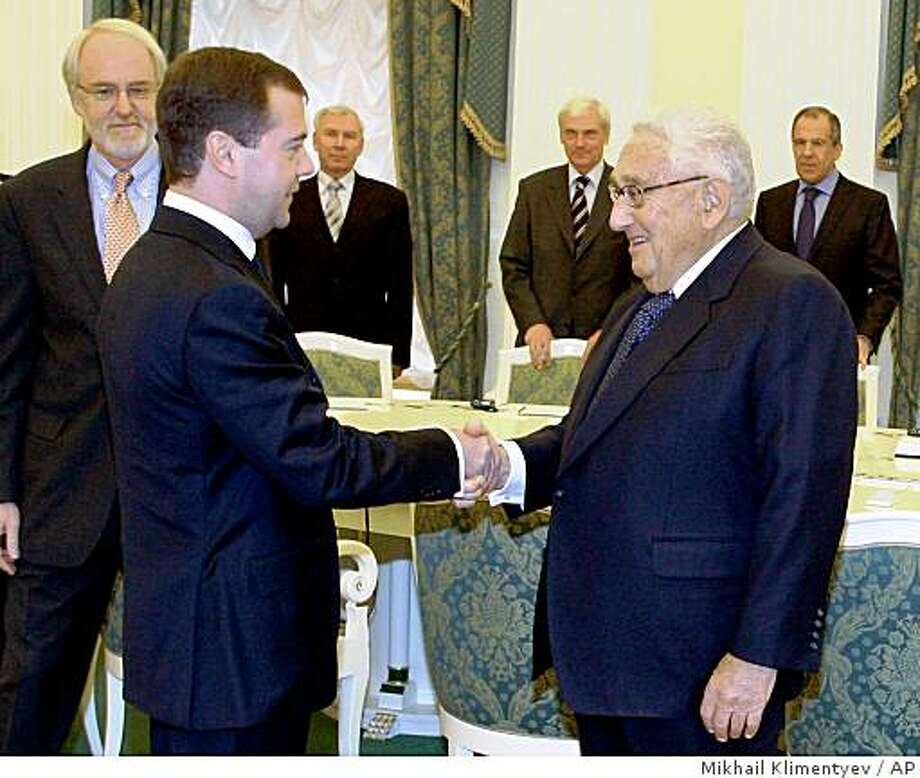 Russian President Dmitry Medvedev, left, greets former U.S. Secretary of State Henry Kissinger during a meeting with a group of U.S. foreign policy veterans at the Kremlin in Moscow, Friday, March 20, 2009. Some of the biggest names in U.S. diplomacy of the past decades met with Russian President Dmitry Medvedev on Friday, in an effort to improve frosty relations that experts say could threaten many U.S. foreign policy goals. (AP Photo/RIA-Novosti, Mikhail Klimentyev, Presidential Press Service) Photo: Mikhail Klimentyev, AP