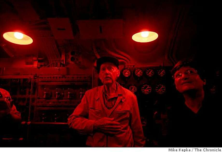 Sixty four years after being rescued by the US Pampanito in the South China Sea, Harold Martin (center), 92, an australian solider during WWII visits the control room on the submarine on Tuesday March 17, 2009 in San Francisco, Calif. Photo: Mike Kepka, The Chronicle