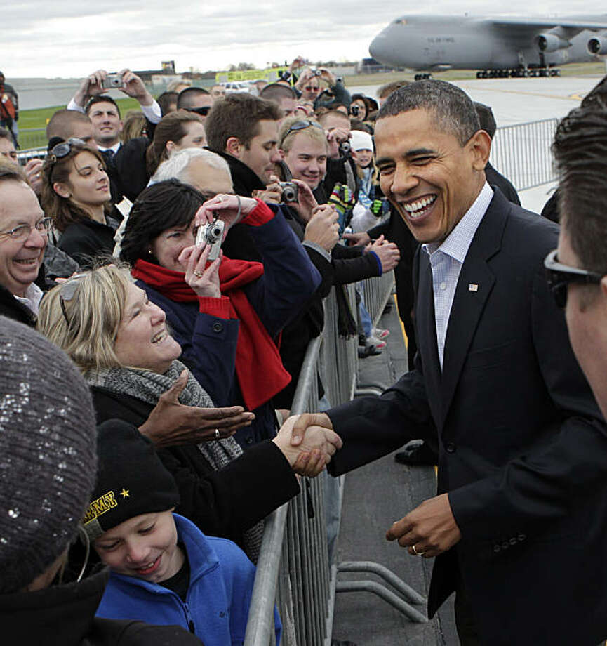 President Barack Obama greets people at Cleveland Hopkins airport before a rally at Cleveland State University, in Cleveland, Sunday, Oct. 31, 2010. Photo: J. Scott Applewhite, AP
