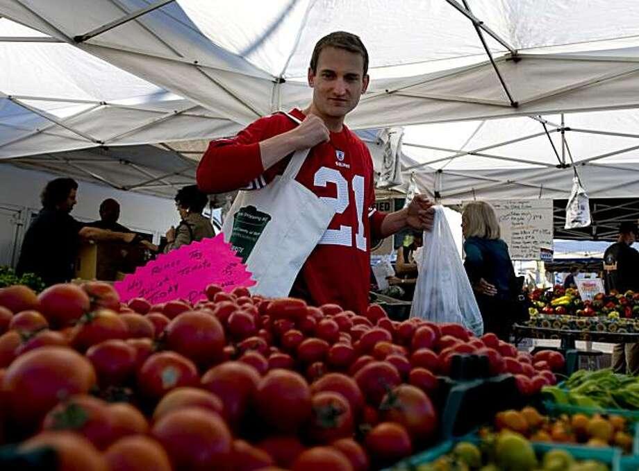 Jim Schutz (pen name Jim Ballard) is seen shopping at the San Rafael farmer's market on Saturday, October 10, 2010 in San Rafael, Calif. Photo: Chad Ziemendorf, The Chronicle