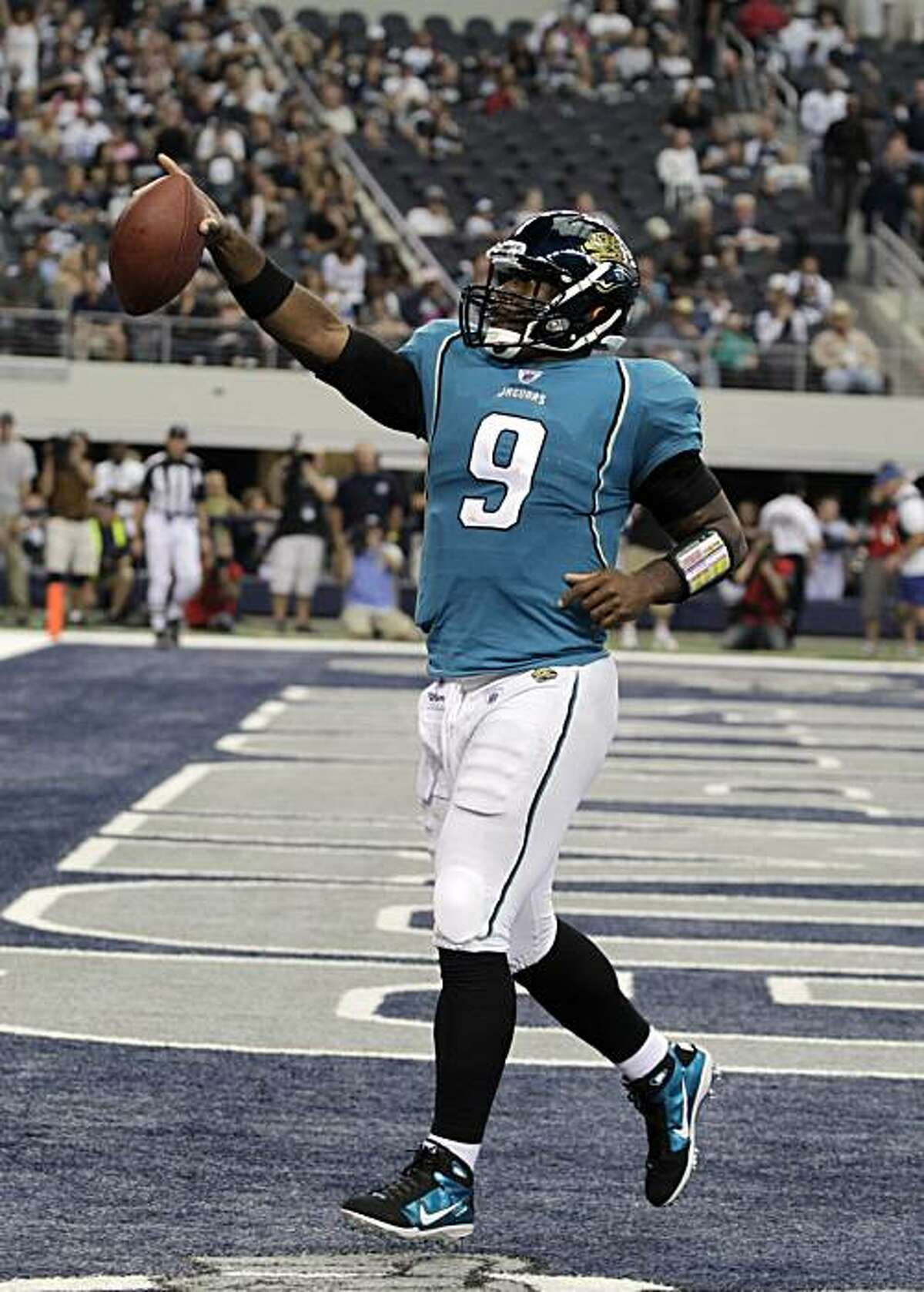 Jacksonville Jaguars quarterback David Garrard (9) celebrates after scoring a touchdown in the fourth quarter during an NFL football game against the Dallas Cowboys in Dallas, Sunday, Oct. 31, 2010.