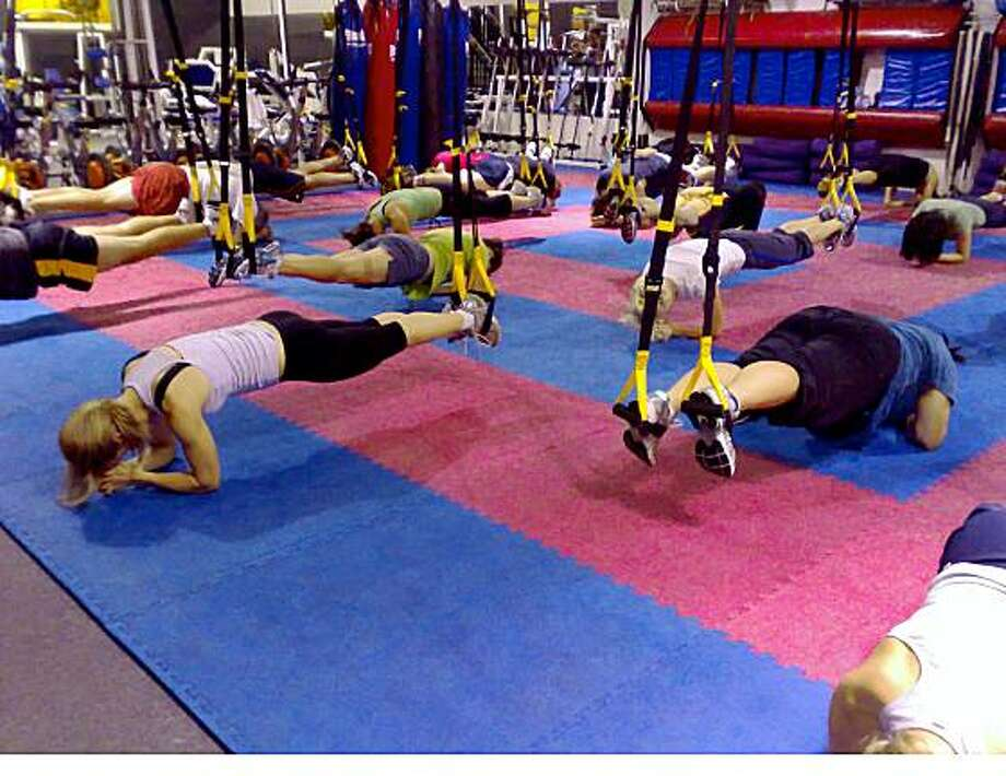 TRX Suspension Trainer (photo from company Fitness Anywhere): A system of elastic bands that leverage the user�s own bodyweight and gravity to develop strength, balance, flexibility and joint stability simultaneously. Think of it as group Pilates.