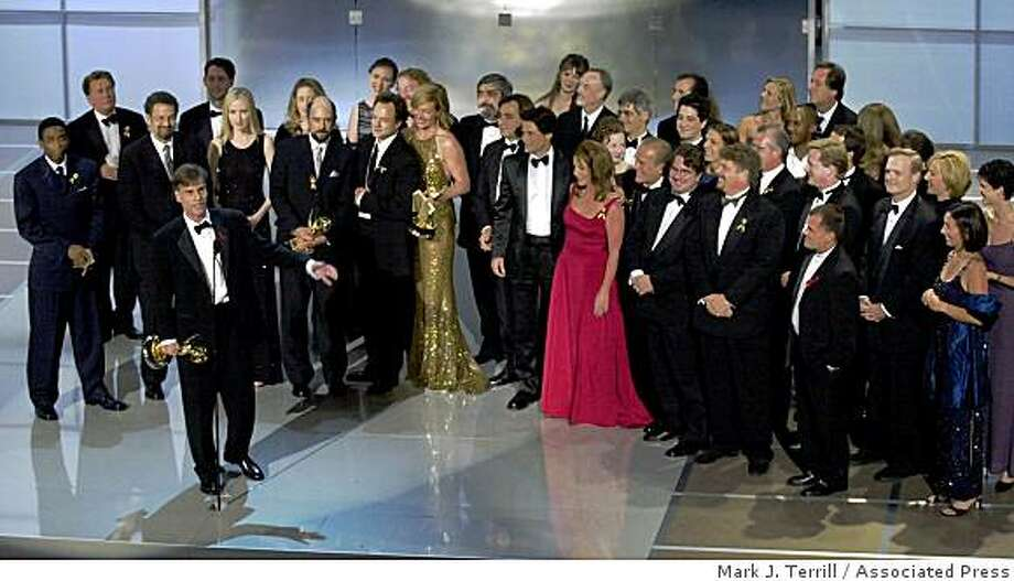 "Aaron Sorkin, writer for ""The West Wing,"" accepts the Emmy award for best dramatic series on behalfof thecase and crew who stand behind him at the Shrine Auditorium in Los Angeles, Sunday, Sept. 10, 2000. Photo: Mark J. Terrill, Associated Press"