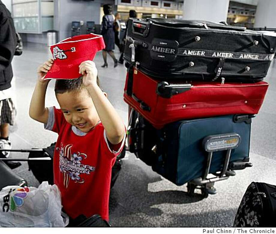 Noah Gaviola, 5, adjusts his visor while waiting for a flight at San Francisco International Airport in San Francisco, Calif., on Tuesday, March 17, 2009. Noah and his family were waiting to board a plane bound for Korea for a two-week vacation. Photo: Paul Chinn, The Chronicle