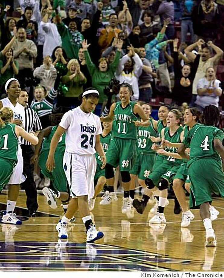 Fans and St. Mary's players explode with emotion as the buzzer sounds and Sacred Heart's Kishawna Moore (24) exits the court as St. Mary's of Stockton beats Sacred Heart of San Francisco 62-60 to win the Northern California Division III Girls Basketball Finals at Arco Arena in Sacramento, Calif., on Saturday, Mar. 14, 2009. Photo: Kim Komenich, The Chronicle