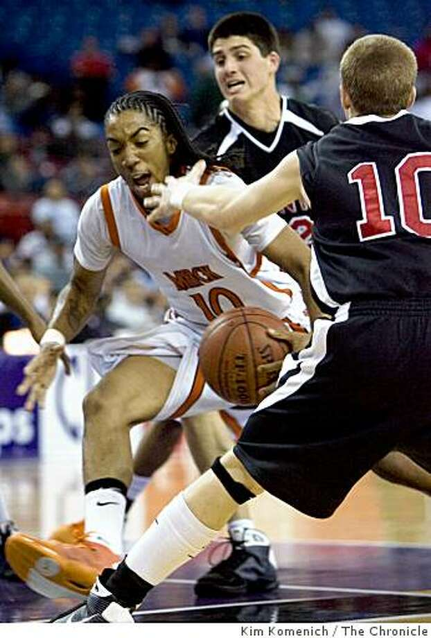 McClymonds High's Justin Standley (10) drives past  Monte Vista High's Mark Appel (background) and Brian Barbour (back to camera) in the first period as McClymonds High of Oakland, Calif., plays Monte Vista High of Danville, Calif., the Northern California Division I Basketball Finals at Arco Arena in Sacramento, Calif., on Saturday, Mar. 14, 2009. Photo: Kim Komenich, The Chronicle