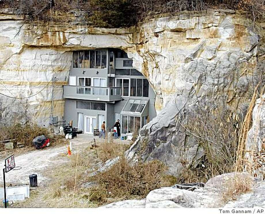 The home of Curt and Deborah Sleeper that was built in a cave, is seen Thursday, Feb. 26, 2009 in Festus, Mo. The Sleepers have put the house on eBay as a backup in case they can't meet a large payment due on the property. (AP Photo/Tom Gannam) Photo: Tom Gannam, AP