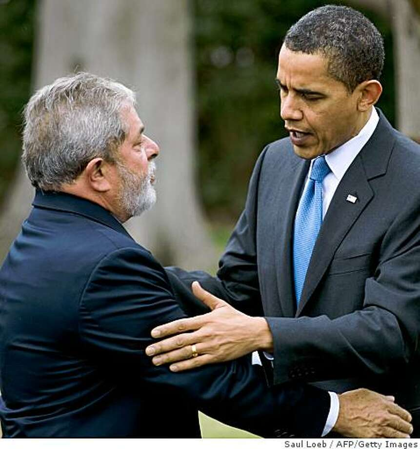 US President Barack Obama (R) embraces Brazil's President Luiz Inacio Lula da Silva (L) as they say goodbye on the South Lawn after meeting in the Oval Office of the White House in Washington, DC, March 14, 2009.   AFP PHOTO / Saul LOEB (Photo credit should read SAUL LOEB/AFP/Getty Images) Photo: Saul Loeb, AFP/Getty Images