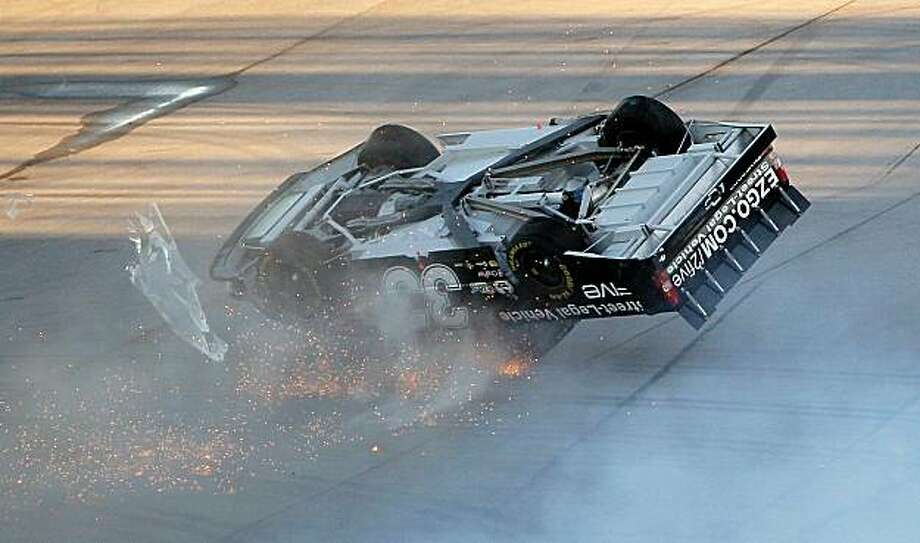 TALLADEGA, AL - OCTOBER 30:  Ron Hornaday Jr., driver of the #33 E-Z-GO 2 Five  Chevrolet, flips in the air after an incident in the NASCAR Camping World Truck Series Mountain Dew 250 at Talladega Superspeedway on October 30, 2010 in Talladega, Alabama. Photo: Kevin C. Cox, Getty Images