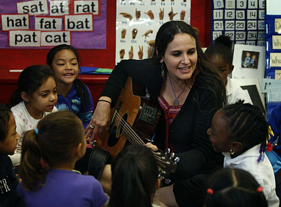 Kindergarten teacher Marisa Martinez leads students in a singalong at El Dorado Elementary School in San Francisco, Calif., on Thursday, Oct. 28, 2010. Martinez produced a music CD with the help of some students to help her school raise money to hire a full-time art teacher. Photo: Paul Chinn, The Chronicle