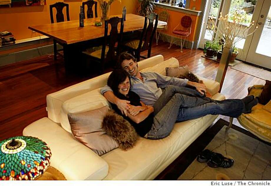 Pascal Molat and Genevieve Brisebois on their couch photographed on Tuesday, February 24, 2009. Photo: Eric Luse, The Chronicle
