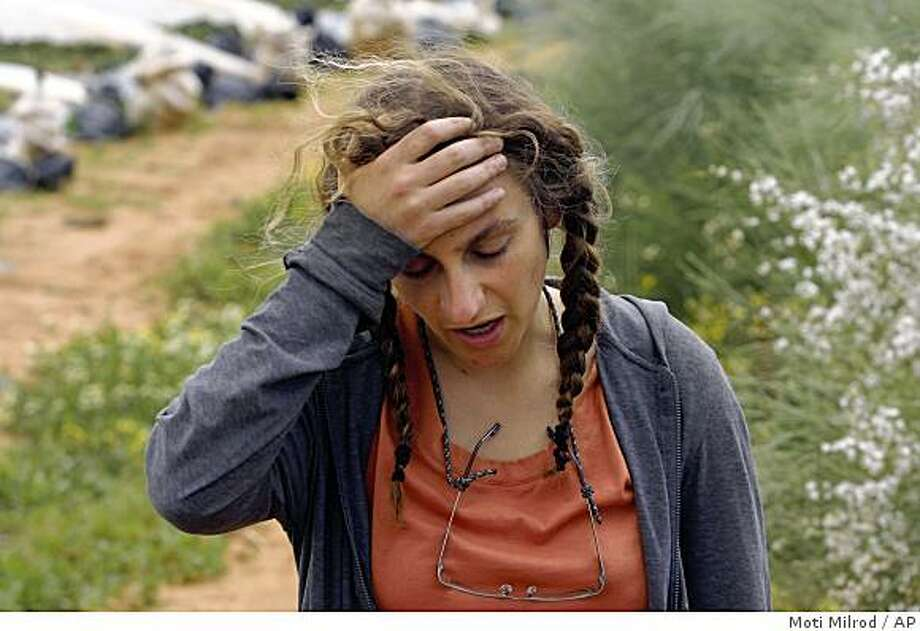 American Gabrielle Silverman, 26, from Oakland, Calif., talks during an interview with The Associated Press outside Tel Hashomer hospital, near Tel Aviv, Israel, Saturday, March 14 2009. Tristan Anderson, 38, of Oakland, Calif., an American activist who was struck in the head by a tear gas canister fired by Israeli troops in the West Bank, was in serious condition Saturday after undergoing extensive surgery, hospital officials said. (AP Photo/Moti Milrod) Photo: Moti Milrod, AP