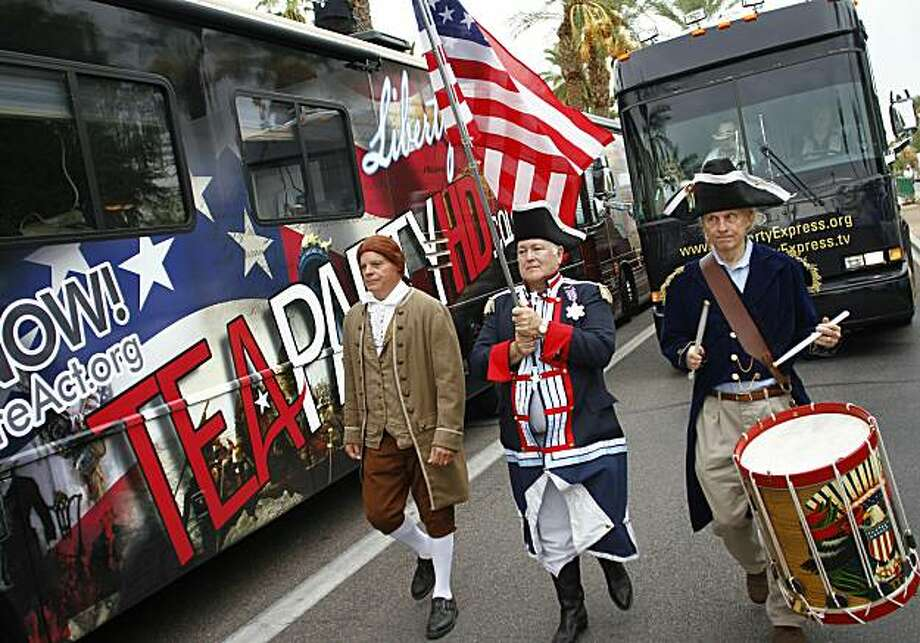 PHOENIX, AZ -  OCTOBER 22:  (L-R) Doctor Lance Hurley, John Rosado and Mitch Markovich wear colonial style attire as they march during the rally for the Tea Party Express national tour October 22, 2010 in Phoenix, Arizona. The tour, part of an initiativeto get conservatives elected to the House and Senate, will move across country and conclude on November 1, 2010 in Concord, New Hampshire the day before the contentious mid-term elections. Photo: Joshua Lott, Getty Images