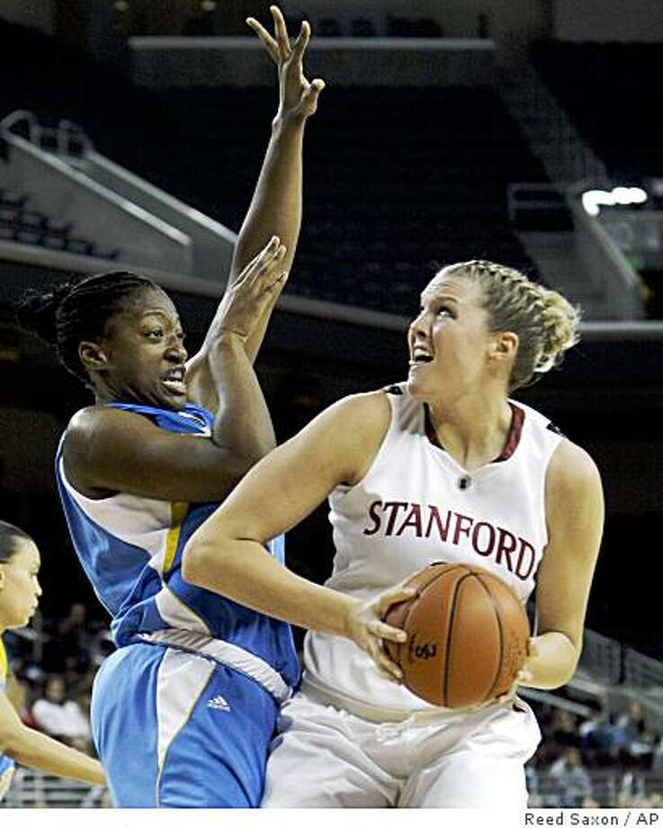 Stanford center Jayne Appel looks for an opening as UCLA guard Atonye Nyingifa defends in the first half of the Pac-10 semifinal in Los Angeles on Saturday. Photo: Reed Saxon, AP