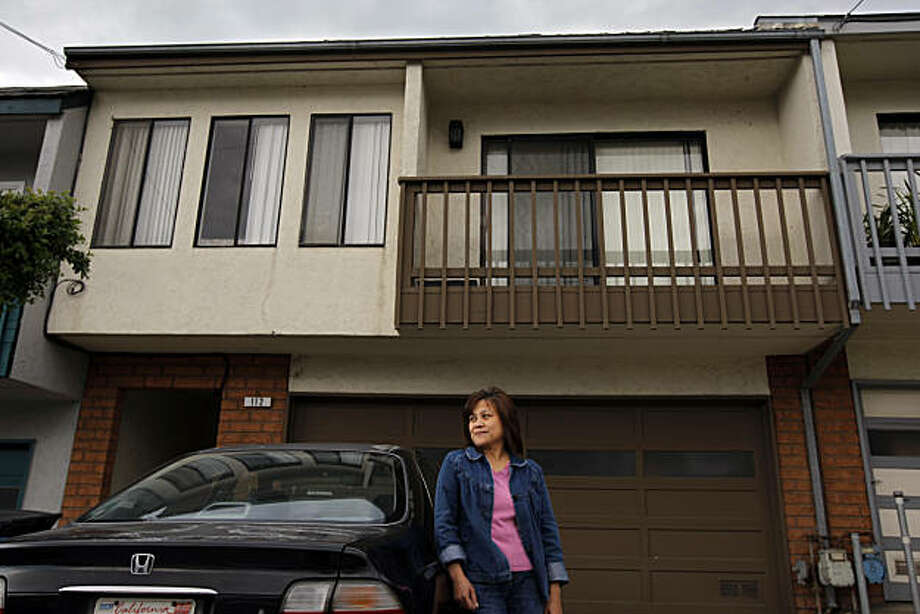 Precy Moya stands in front of her home Thursday, October 28, 2010, Daly City, Calif.  Moya is a home owner who was foreclosed on and taken to court to be evicted even though she says she never received any notice of foreclosure or eviction. Photo: Adm Golub, The Chronicle