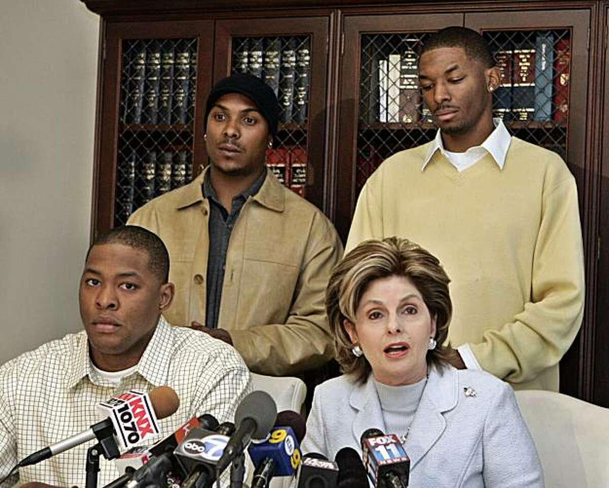 ** ADVANCE FOR USE ON TUESDAY, OCT. 26, 2010 AND THEREAFTER ** FILE - In this Friday, Dec. 1, 2006 file picture, attorney Gloria Allred speaks during a news conference at her office in Los Angeles accompanied by Kyle Doss, lower left, Patrick McLucas, topleft, and Frank McBride, all present at a comedy club during a Michael Richards tirade. Allred is comfortable with controversy. Indeed, if there has been a divisive or offbeat _ or sometimes both _ cause to support over the past 35 years, Allred was there. There is, however, another side of her.