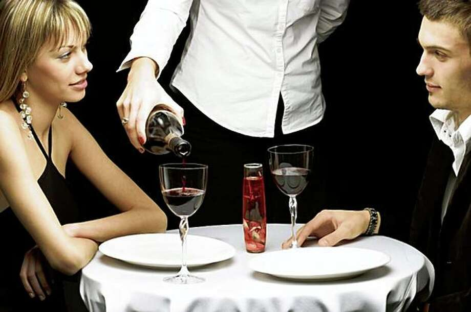 """with insight column """"behave yourself"""" Young beautiful couple having a dinner in a restaurant Photo: IStockphoto.com Goldmund"""