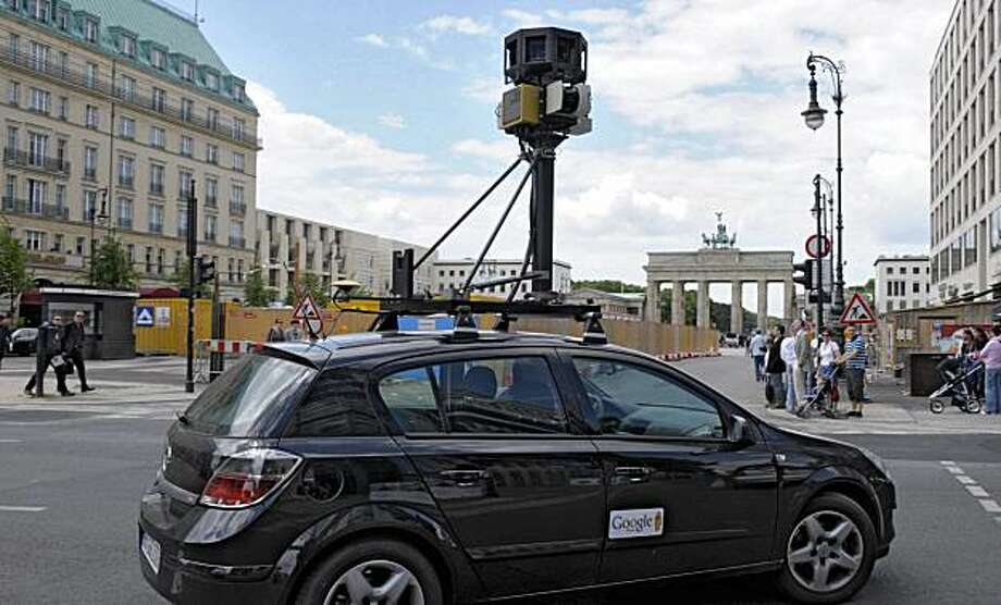 FILE - In this July 9, 2008 file photo a google street view car drives near the Brandenburg Gate in Berlin, Germany.  Italian prosecutors have opened an investigation into Google's Street View for suspected violation of privacy. Google said in a statementin reaction to the probe Wednesday, Oct. 27, 2010 that it would cooperate with authorities and apologized for any inadvertent collection of private data from unencrypted networks in Italy. Photo: Michael Kappeler, AP