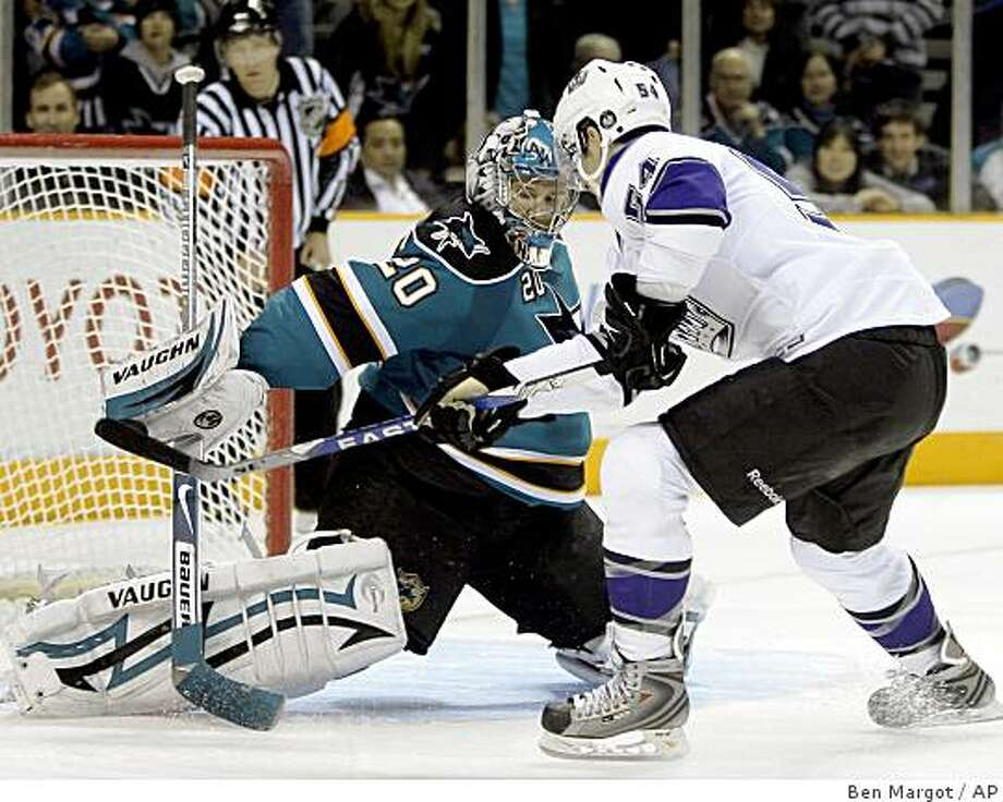 San Jose Sharks goalie Evgeni Nabokov (20) defends against Los Angeles Kings' Teddy Purcell during a shootout of an NHL hockey game Saturday, March 14, 2009, in San Jose, Calif. (AP Photo/Ben Margot) Photo: Ben Margot, AP