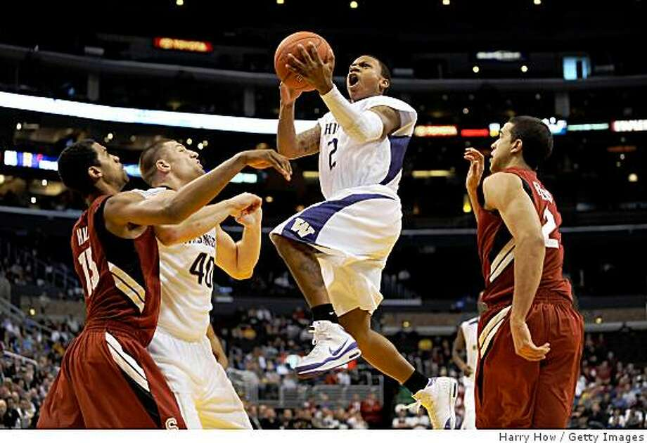 Guard Isaiah Thomas #2 of the Washington Huskies takes a shot during their 85-73 win over the Stanford Cardinal in the Pacific Life Pac-10 Men's Basketball Tournament at the Staples Center on March 12, 2009 in Los Angeles, California. Photo: Harry How, Getty Images