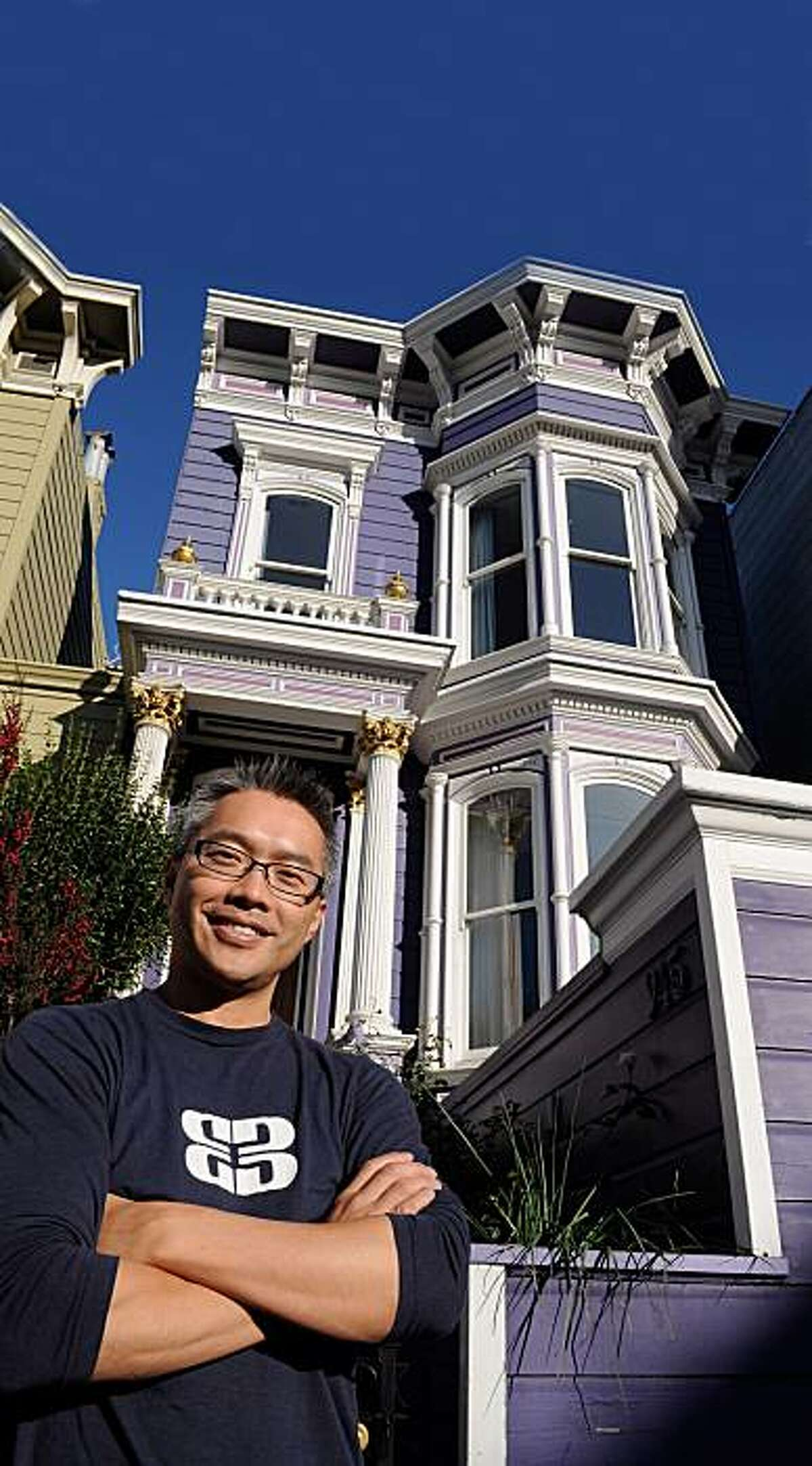 Kong Son outside the home at 945 Valencia for the real estate cover.