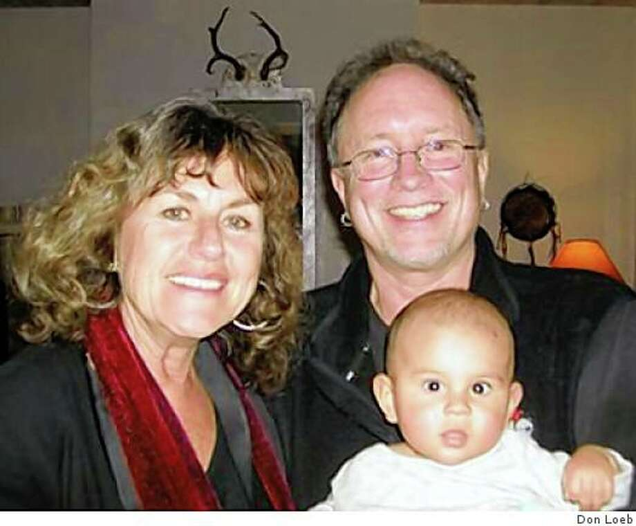A photo taken at Sundance Jan 2003 of Bill Ayers and Bernardine Dohrn. They are holding the producer of the movie's baby. Her name is Carrie Lozano and her son is named Diego. Photo: Don Loeb