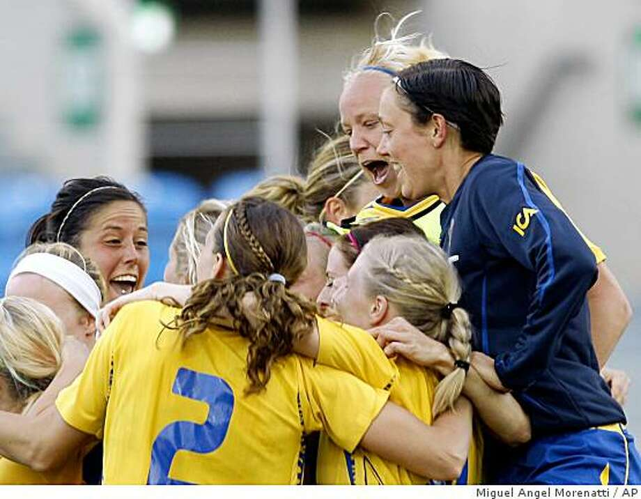 Team Sweden celebrates after defeating the United States in their women's soccer Algarve Cup final Wednesday, March 11 2009, outside Faro, southern Portugal.  Sweden defeated the US 4-3 in a penalty shoot-out after the game ended in a 1-1 draw. Photo: Miguel Angel Morenatti, AP