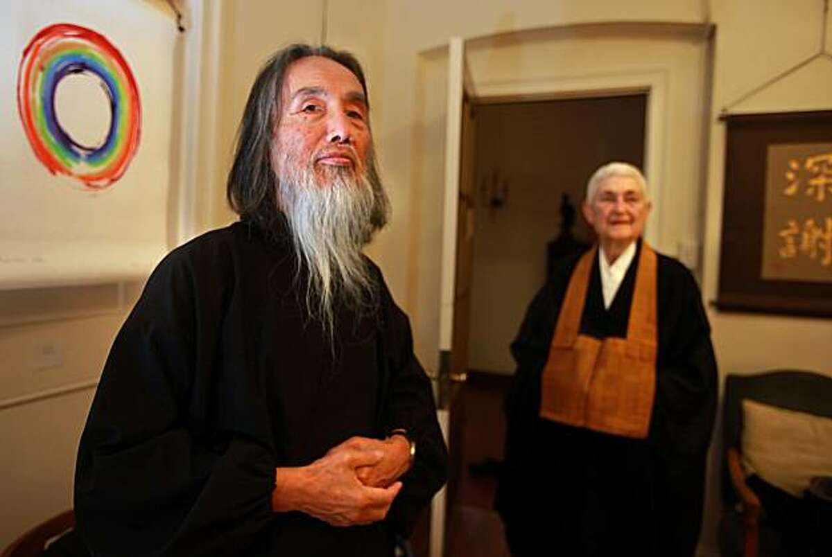 Kazuaki Tanahashi (left), a Buddhist scholar, artist and teacher, getting ready for an art show at the San Francisco Zen Center in San Francisco, Calif., on Friday, October 22, 2010. Kazuaki has been working on a translation of Dogen, one of the great thinkers in Zen Buddhism. It took him 50 years to complete the translation of the 13th century master's work.