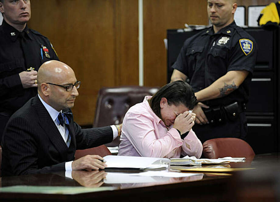 Carmen Huertas reacts to her sentencing with her attorney Steven Rubin by her side inside state supreme court, Friday, Oct. 29, 2010, in New York. Huertas received a prison sentence of four to 12 years after pleading guilty to killing 11-year-old Leandra Rosado in a drunken driving crash on the Henry Hudson Parkway in October 2009. ( AP Photo/Louis Lanzano) Photo: Louis Lanzano, AP