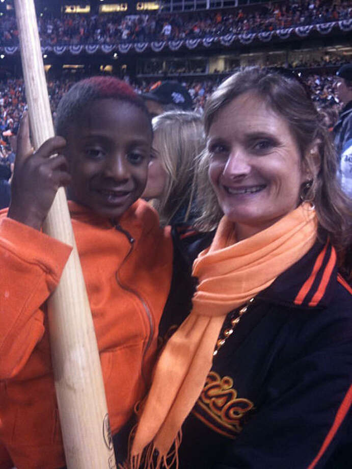 Jesse Steyer, 6, holds a Buster Posey bat which flew into the stands while he sat with his parents during the second game of the World Series at AT&T Park Thursday Oct. 28, 2010 in San Francisco, Calif. Photo: Demian Bulwa, The Chronicle
