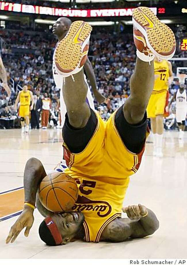 Cleveland Cavaliers LeBron James rolls on the court after being fouled in the fourth quarter of a game at US Airways Center in Phoenix, Ariz., Thursday March 12, 2009. Photo: Rob Schumacher, AP