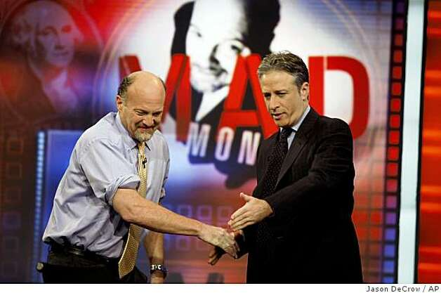 "Jim Cramer, left, host of the ""Mad Money"" show on CNBC, is welcomed by Jon Stewart during an appearance on Comedy Central's ""The Daily Show with Jon Stewart"" Thursday, March 12, 2009 in New York. Photo: Jason DeCrow, AP"