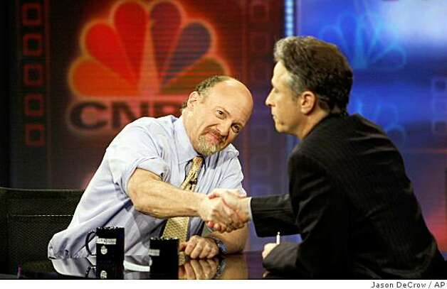 "Jim Cramer, left, host of CNBC's ""Mad Money"" show shakes hands with Jon Stewart during an appearance on Comedy Central's ""The Daily Show with Jon Stewart"" Thursday, March 12, 2009 in New York.  (AP Photo/Jason DeCrow) Photo: Jason DeCrow, AP"