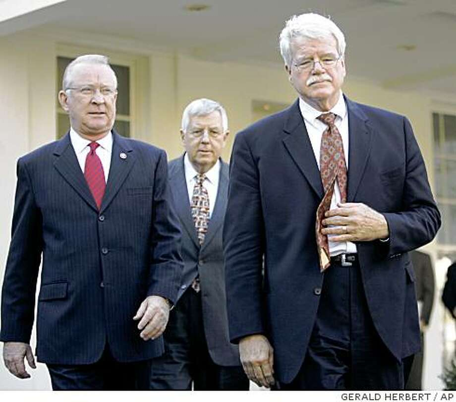 Rep. Buck McKeon, R-Calif., left, Sen. Mike Enzi, R-Wyo., center, and Rep. George Miller, D-Calif. leave the White House in Washington, Monday, Jan. 8, 2007. Photo: GERALD HERBERT, AP