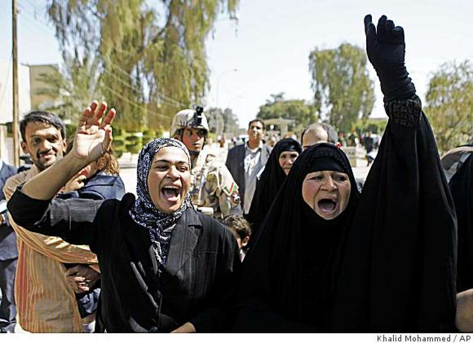 """Relatives of the Iraqi journalist who threw shoes at then-President George W. Bush reacts after his brother Muntadhar al-Zeidi was convicted of assaulting a foreign leader and sentenced to three years in prison in Baghdad, Iraq, Thursday, March 12, 2009. The verdict came after a short trial in which Muntadhar al-Zeidi, 30, pleaded not guilty to the charge and said his action was a """"natural response to the occupation.""""  (AP Photo/Khalid Mohammed) Photo: Khalid Mohammed, AP"""