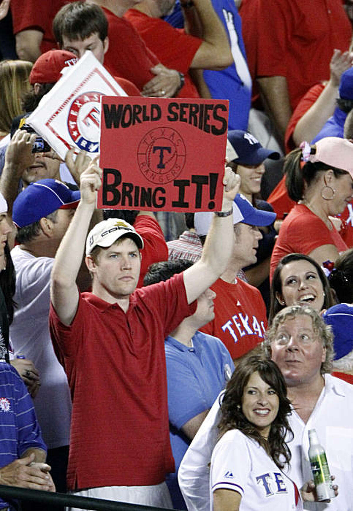 A Texas Rangers fan looks ahead in the seventh inning of Game 6 of baseball's American League Championship Series against the New York Yankees Friday, Oct. 22, 2010, in Arlington, Texas.