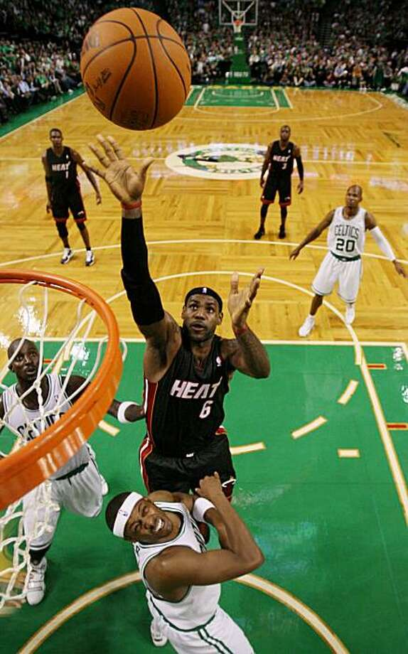 Miami Heat's LeBron James shoots over Boston Celtics' Paul Pierce and Kevin Garnett, left, during the first half of an NBA basketball game in Boston on Tuesday, Oct. 26, 2010. Photo: Winslow Townson, AP