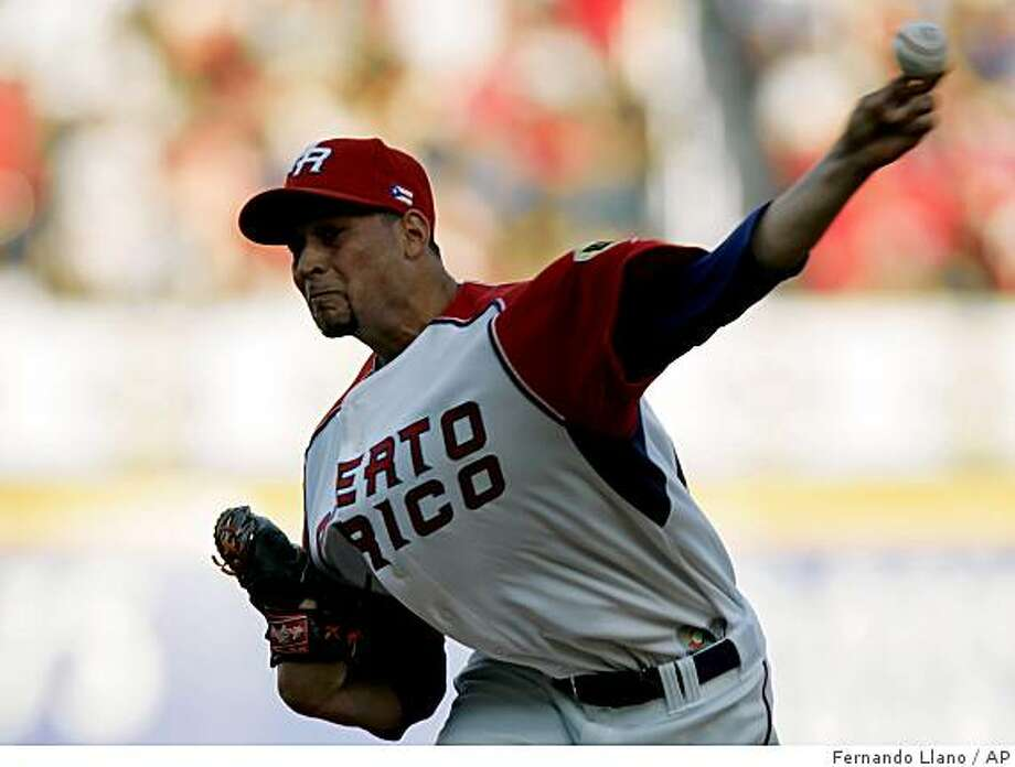 Puerto Rico's starting  pitcher Jonathan Sanchez  throws  a ball in the first inning of a  World Baseball Classic game against Netherlands in San Juan, Wednesday, March 11, 2009. (AP Photo/Fernando Llano) Photo: Fernando Llano, AP