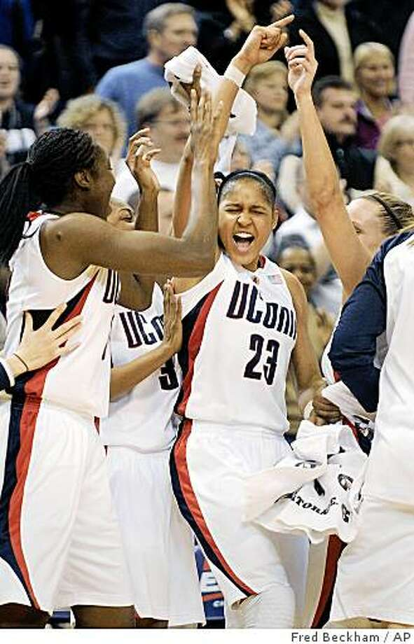 Connecticut's Tina Charles, Tiffany Hayes, Maya Moore, and Meghan Gardler, from left, celebrate after Connecticut's 75-36 victory over Louisville in the Big East women's tournament championship game in Hartford, Conn., on Tuesday, March 10, 2009. Moore scored a game-high 28 points, had five rebounds, and was named the tournament's most outstanding player. Photo: Fred Beckham, AP