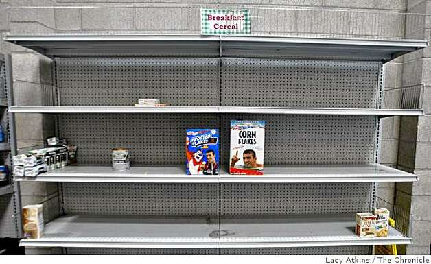 Only two boxes are left standing on the cereal shelves at the San Francisco Food Bank after nine flats of Kellogg's cereal were donated with Michael Phelps face on in, Monday March 9, 2009, in San Francisco, Calif. Photo: Lacy Atkins, The Chronicle